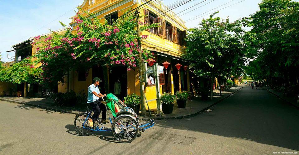 Riding a rickshaw through Hoi An Ancient Town